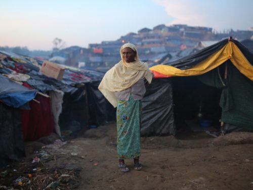 A Rohingya woman stands at Palangkhali refugee camp in Cox's Bazar, Bangladesh, Wednesday, Oct. 4, 2017. More than half a million Rohingya have fled from Myanmar to Bangladesh in just over a month, the largest refugee crisis to hit Asia in decades. (AP Photo/Zakir Hossain Chowdhury)